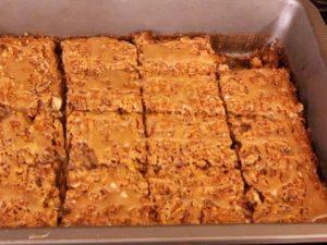 Pecan pie bars with shortbread bottom and a bourbon maple glaze.