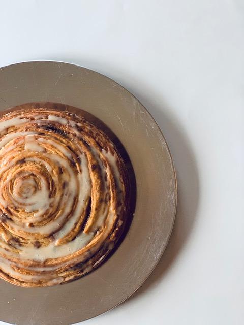 big cinnamon roll with caramel vanilla glaze
